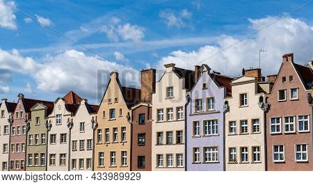 Colorful House Fronts Of Row Houses On The Riverfront Of The Motlawa River In The Old Town Of Gdansk