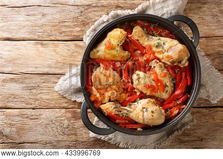 Basque Braised Chicken With Peppers Poulet Basquaise Close Up In The Pan On The Table. Horizontal To
