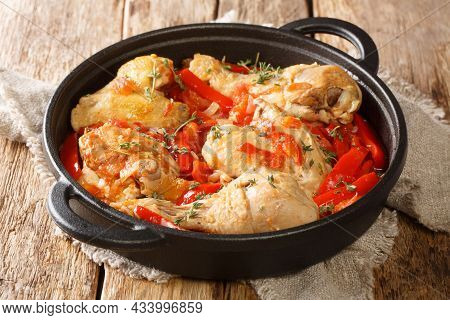 Basque Chicken Or Poulet Basquaise With Vegetables Close Up In The Pan On The Table. Horizontal