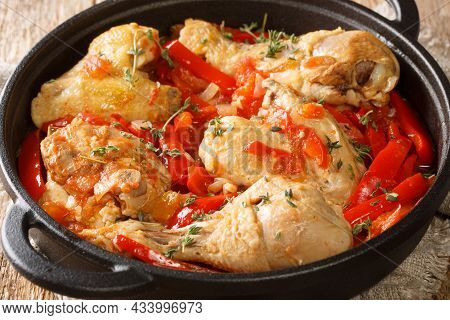 Basque Braised Chicken With Peppers Poulet Basquaise Close Up In The Pan On The Table. Horizontal