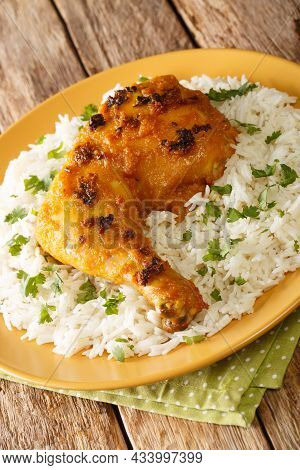 Malaysian Roasted Spiced Chicken Ayam Percik With Rice Close Up In The Plate. Vertical