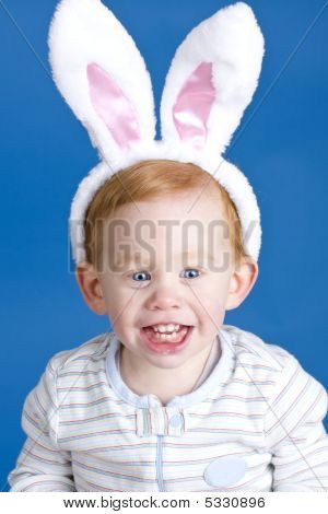 Cute baby wearing Easter bunny ears on blue poster