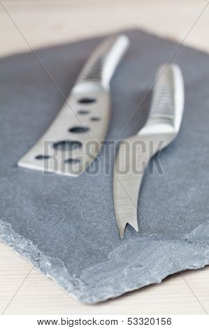 Cheese Knives On Slate Board
