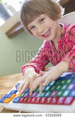 Child Typing On Colourful Computer Keyboard