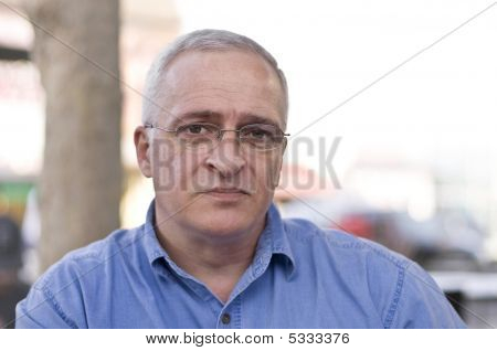 Close-up Portrait Of A Sad Senior Man, Shallow Depth Of Field