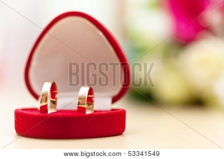 Golden wedding rings and bridal bouquet