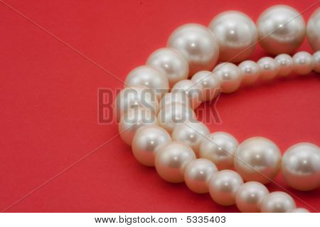 Pearls Isolated On Red