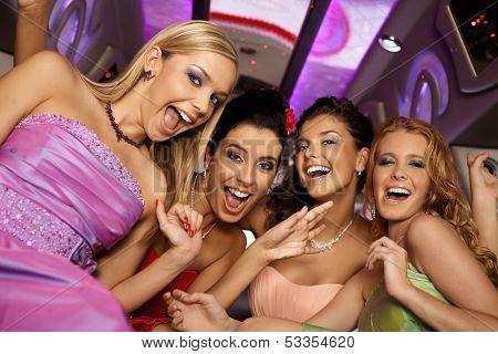 Beautiful girl having party, laughing, looking at camera.