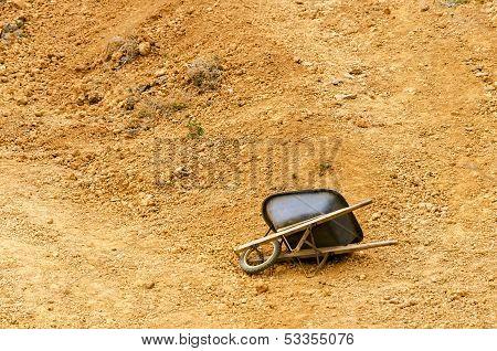 Wheelbarrow And Dirt