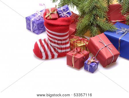 santa stocking  and  gift boxes  under decorated Christmas tree.isolated on white background  poster
