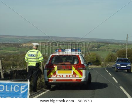 Police Car And Slow Sign