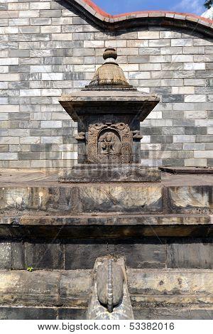 Graved Statue Of God Shiva On A Public Stone Fountain. Pashupatinath, Nepal