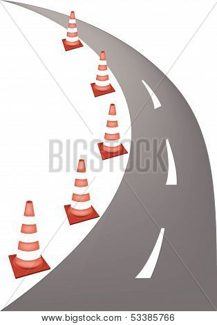 A Row of Orange and White Safety Road Cones or Traffic Cones on A Road for Traffic Redirection or Warning of Hazards or Dangers.. poster
