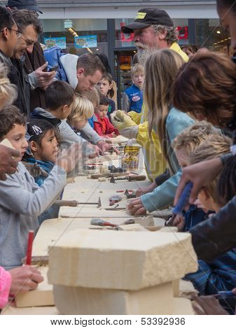 Kids Learning To Carve At Sculpture Festival