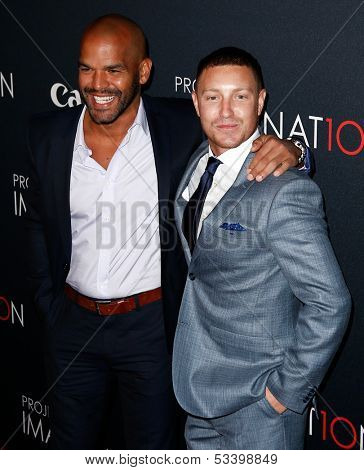 NEW YORK- OCT 24: Actors Amaury Nolasco and Lane Garrison (R) attend Canon's 'Project Imaginat10n' Film Festival at Alice Tully Hall at Lincoln Center on October 24, 2013 in New York City.