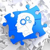 Psychological Concept - Profile of Head with Cogwheel Gear Mechanism Located on Blue Puzzle. poster