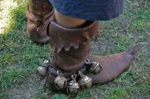 medieval leather boots with bells of the bagpipe musitian poster