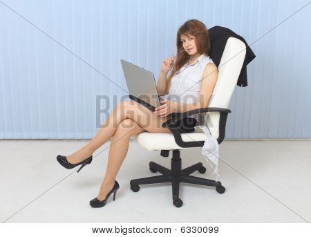 Young Sexual Girl - Secretary Sits In An Armchair With Laptop