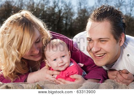 Happy Smiling Young Family