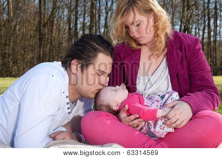 Daddy Is Kissing His Baby Girl