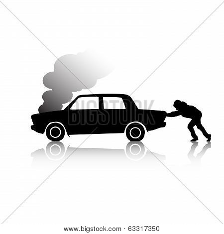 Silhouette of man pushing a broken car