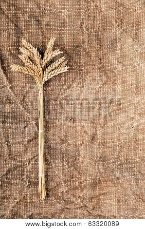 Wheat Ears On A Textile Background