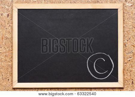 Letter C written on chalkboard, getting bad grades