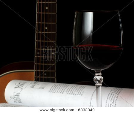 Wineglass, Guitar And Music Notes