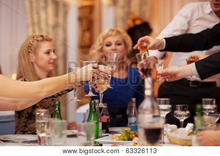 Friends raising their glasses in a toast