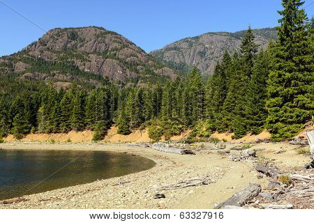 The Peaks of Strathcona Provincial Park by the Shore of Buttle Lake poster