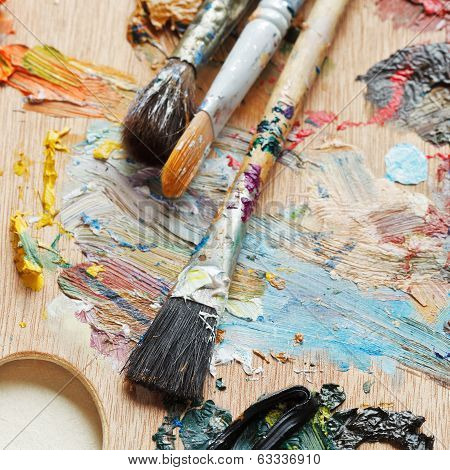 Few Paintbrushes On Used Artistic Pallette