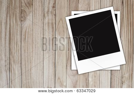 Photo frame on Brown wood plank wall texture