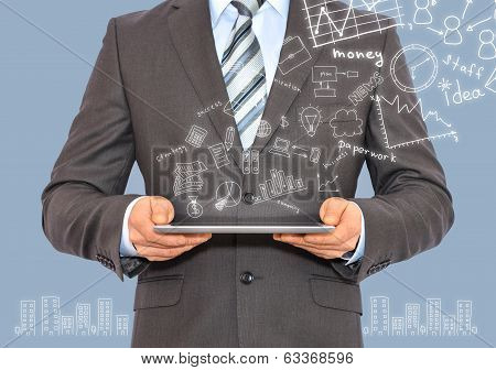 Man with tablet in hands and business sketches