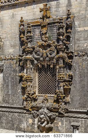 Tomar, Portugal - July 18, 2013: Famous Chapter House Manueline style window, in the Templar Convent of Christ in Tomar, Portugal. UNESCO World Heritage