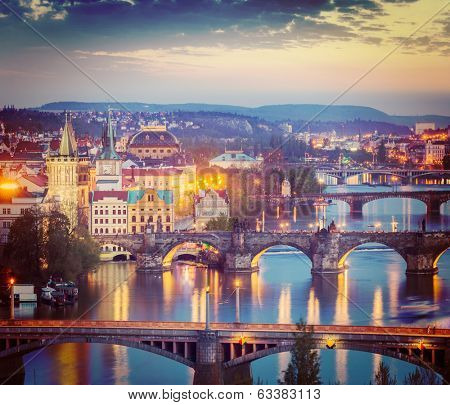Vintage retro hipster style travel image of travel Prague concept background - elevated view of bridges over Vltava river from Letn���¡ Park. Prague, Czech Republic in twilight