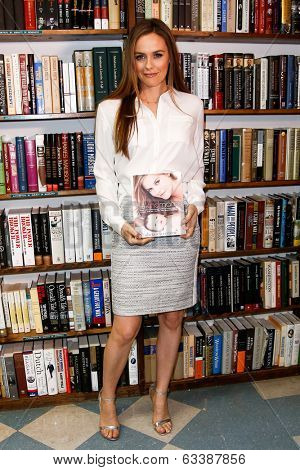 HUNTINGTON, NY-APR 15: Actress Alicia Silverstone signs copies of her book 'The Kind Mama' on April 15, 2014 at the Book Revue in Huntington, New York.