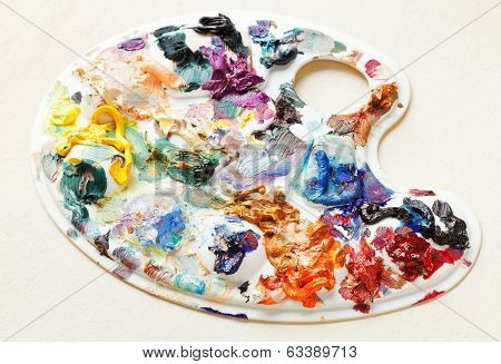 Artistic Pallette With Oil Paints On Blank Paper