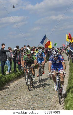 Cyclists Riding Paris-roubaix 2014