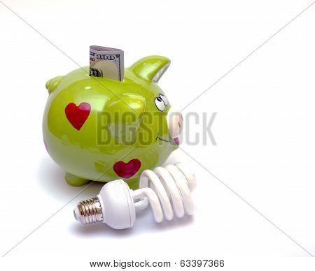 Piggy bank with a CF bulb near (smart energy)