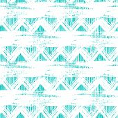 Vector seamless ethnic zigzag pattern with bold brushstrokes and stripes in bright aqua blue color can be used for print, wallpaper, spring summer fashion and home decor poster