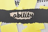 The word ability against sticky notes strewn over notepad poster