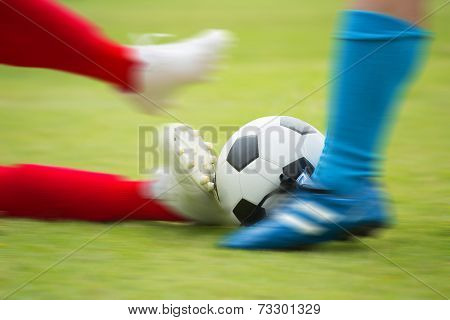 Soccer Player Striking The Ball