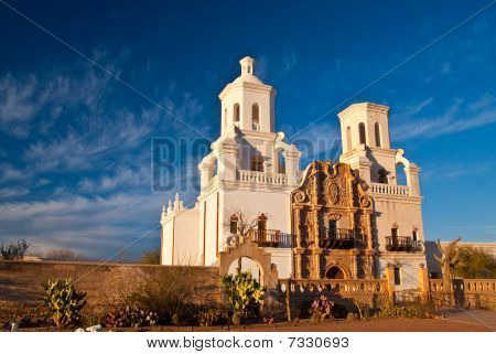 Sunset highlights Mission San Xavier near Tucson Arizona poster