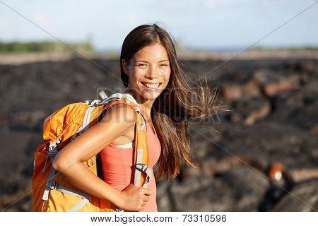 Hiking woman - hiker walking on lava field on Hawaii. Tourist on hike near Kilauea volcano around Hawaii volcanoes national park, USA.