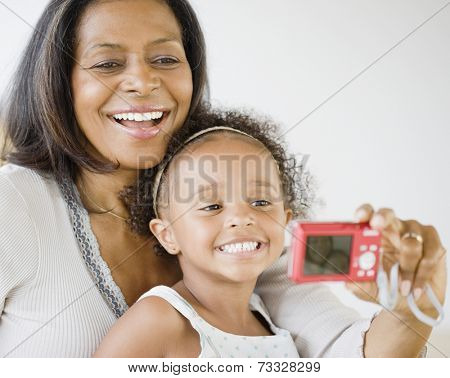 African grandmother and granddaughter smiling for self-portrait