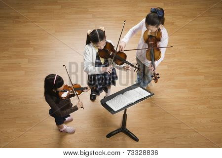 Asian girls playing violins