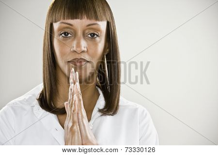 African woman with hands pressed together