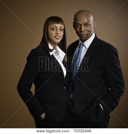 African businesspeople with hands in pockets