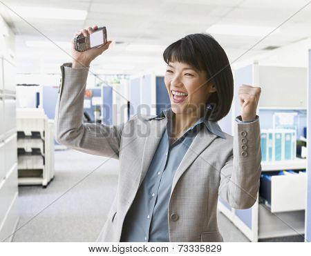 Asian businesswoman cheering