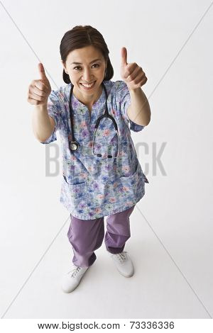 Asian female nurse giving thumbs up